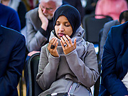 16 MARCH 2019 - BLOOMINGTON, MINNESOTA, USA: Congresswoman ILHAM OMAR (D-MN) prays during the benediction at Dar al Farooq Center in Bloomington. She is the first Somali-American elected to congress. An interdenominational crowd of about 1,000 people came to the center to protest white supremacy and religious intolerance and to support Muslims in New Zealand who were massacred by a white supremacist Friday. The Twin Cities has a large Muslim community following decades of Somali immigration to Minnesota. There are about 45,000 people of Somali descent in the Twin Cities.   PHOTO BY JACK KURTZ