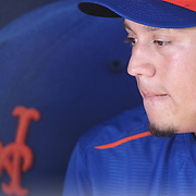 Wilmer Flores, New York Mets, reflecting on his week with a reporter in the dugout before the New York Mets Vs Washington Nationals. MLB regular season baseball game at Citi Field, Queens, New York. USA. 1st August 2015. (Tim Clayton for New York Daily News)