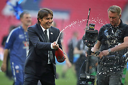 Chelsea manager Antonio Conte celebrates with champagne after the game