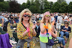 People enjoying themselves at Let's Rock, 1980s retro music festival, Earlham Park, Norwich UK 24 June 2017 UK