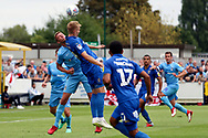 AFC Wimbledon striker Joe Pigott (39) winning header in the box during the EFL Sky Bet League 1 match between AFC Wimbledon and Coventry City at the Cherry Red Records Stadium, Kingston, England on 11 August 2018.