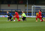 Stephen Humphrys of Rochdale (9) referee Bobby Madley and Wigan Athletic forward Kyle Joseph (22) and Wigan Athletic forward Will Keane(10) take a knee before kick off in support of Black Lives matter before the EFL Sky Bet League 1 match between Rochdale and Wigan Athletic at the Crown Oil Arena, Rochdale, England on 16 January 2021.