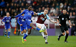 Leicester City's Wilfred Ndidi (left) and Burnley's Ashley Barnes (centre) battle for the ball during the Premier League match at Turf Moor, Burnley.