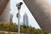 Security CCTV camera at the base of the Oriental Pearl Tower with the Jin Mao Building behind in Shanghai, China.