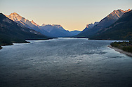 A view of a wind swept Waterton Lake at sunset in Waterton Lakes National Park, Alberta, Canada.