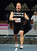 Adam Nelson removes T-Shirt solicting sponsorship prepares to throw in the shot put in the 99th Millrose Games at Madison Square Garden in New York City, N.Y. on Friday, February 3, 2006. Nelson finished third at 63-8 3/4 (19.42m).