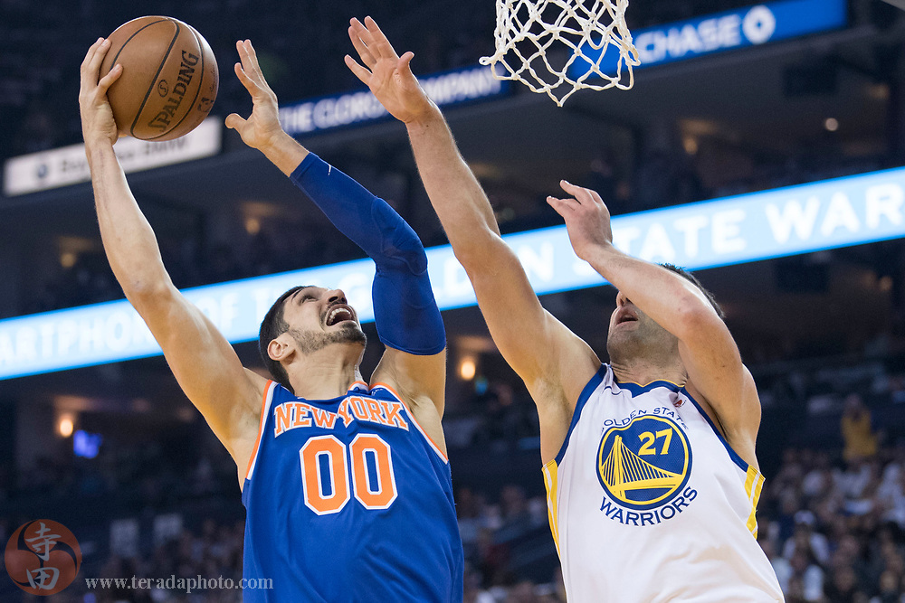 January 23, 2018; Oakland, CA, USA; New York Knicks center Enes Kanter (00) shoots the basketball against Golden State Warriors center Zaza Pachulia (27) during the first quarter at Oracle Arena.