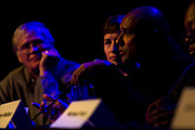 """Tariq Saqqaf, right, Madison's neighborhood resource coordinator, makes a point made during the panel: """"How can Madison build more great neighborhoods?"""" at High Noon Saloon in Madison, Tuesday, November 7, 2017."""