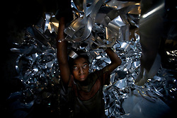 Zihadul Islam, 12, works at aluminum factory in Dhaka, Bangladesh. He works 8 hours a day 6 days a week and earns 1400tks (US$20) a month (70tks=US1D)
