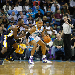 December 17, 2010; New Orleans, LA, USA; New Orleans Hornets power forward David West (30) is guarded by Utah Jazz center Al Jefferson (25) during the first half at the New Orleans Arena.  The Hornets defeated the Jazz 100-71. Mandatory Credit: Derick E. Hingle