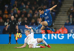 """Leicester City's Shinji Okazaki (right) and Burnley's Ben Mee battle for the ball during the Premier League match at the King Power Stadium, Leicester. PRESS ASSOCIATION Photo Picture date: Saturday December 2, 2017. See PA story SOCCER Leicester. Photo credit should read: Mike Egerton/PA Wire. RESTRICTIONS: EDITORIAL USE ONLY No use with unauthorised audio, video, data, fixture lists, club/league logos or """"live"""" services. Online in-match use limited to 75 images, no video emulation. No use in betting, games or single club/league/player publications."""