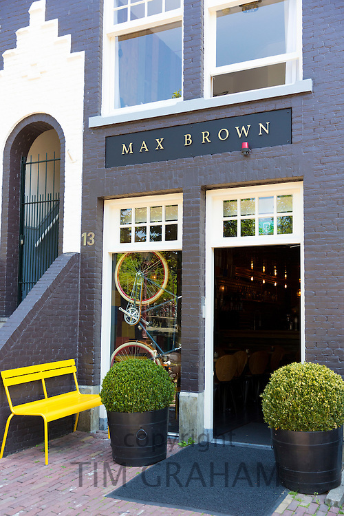 Bicycle in window of Max Brown Hotel a chic, upmarket contemporary boutique hotel, Herengracht, canal district, Amsterdam, Netherlands