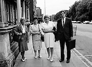 As part of her campaign to prove the innocence of the Maguire Seven and the Guildford Four, Annie Maguire takes her case to Tánaiste Brian Lenihan, at Iveagh House in Dublin. The Four and Seven were wrongly convicted of pub bombings carried out by the IRA in England. (l–r:) Annie's sister Mary McCaffery, Annie Maguire, Therese Smalley and Errol Smalley, Chairman of the Guildford Four and Maguire Family Relatives Support Group.<br /> 7 July 1987