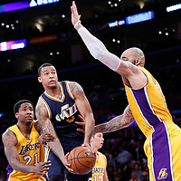 19 March 2015: Utah Jazz guard Trey Burke (3) goes for the layup past Los Angeles Lakers forward Ed Davis (21) and Los Angeles Lakers forward Carlos Boozer (5) during the Utah Jazz 80-73 victory over the Los Angeles Lakers, at the Staples Center, Los Angeles, California, USA.