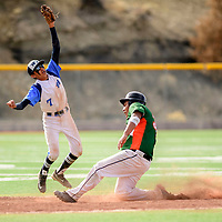 Window Rock Scout Rainer Morgan (7), left, reaches for a throw as Wingate Bear Terrence Howe (35) slides into second base during the Wingate Baseball Slam tournament at Ford Canyon Park in Gallup Friday.