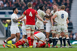 England Lock George Kruis celebrates with Lock Maro Itoje and replacement Danny Care after Wales Flanker Dan Lydiate is penalised for holding on - Mandatory byline: Rogan Thomson/JMP - 12/03/2016 - RUGBY UNION - Twickenham Stadium - London, England - England v Wales - RBS 6 Nations 2016.