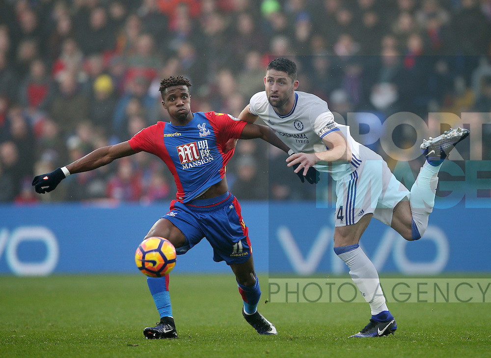 Crystal Palace's Wilfred Zaha tussles with Chelsea's Gary Cahill during the Premier League match at Selhurst Park Stadium, London. Picture date December 17th, 2016 Pic David Klein/Sportimage