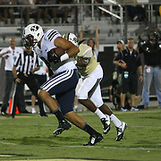 ORLANDO, FL - OCTOBER 09: Devin Mahina #84 of the Brigham Young Cougars runs the football in for a touchdown in the third quarter at Bright House Networks Stadium on October 9, 2014 in Orlando, Florida. (Photo by Alex Menendez/Getty Images) *** Local Caption *** Devin Mahina