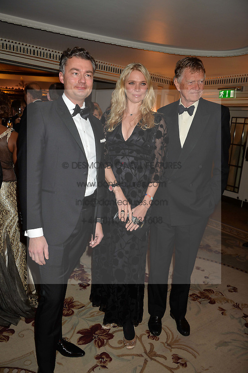 Left to right, LAURENT FENIOU, JODIE KIDD and JOHNNIE KIDD at the 26th Cartier Racing Awards held at The Dorchester, Park Lane, London on 8th November 2016.
