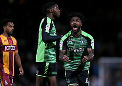 Plymouth Argyle's Yann Songo'o (right) celebrates the win after the final whistle