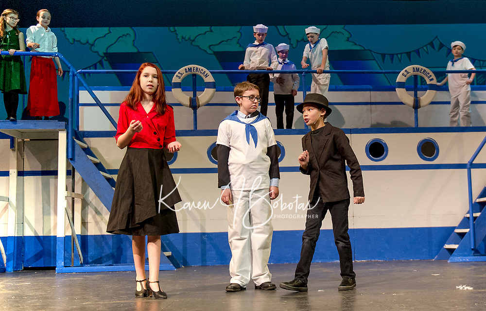 Brenna O'Connor as Reno, Jesse Powers as Billy Crocker and Nehemiah Marquis as Moonface Martin, public enemy #13, making a plan on board the S. S. American during dress rehearsal for Anything Goes with Giilford Middle School.  (Karen Bobotas/for the Laconia Daily Sun)