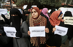January 2, 2018 - Gaza City, Gaza Strip, Palestinian Territory - Palestinian employees of Gaza strip hold banners and Palestine flags during a demonstration demanding their rights, in Gaza city, on January 2, 2018  (Credit Image: © Mohammed Asad/APA Images via ZUMA Wire)