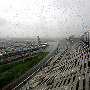 The view from above the track shows rain falling and causing a delay during the 56th Annual NASCAR Daytona 500 practice session at Daytona International Speedway on Saturday, February 22, 2014 in Daytona Beach, Florida.  (AP Photo/Alex Menendez)