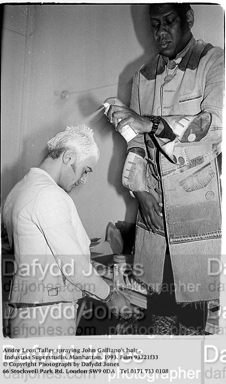 Andre Leon Talley spraying John Galliano's hair . Industria Superstudio. Manhattan. 1993. Film 93221f33<br /> © Copyright Photograph by Dafydd Jones<br /> 66 Stockwell Park Rd. London SW9 0DA<br /> Tel 0171 733 0108