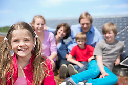 Portrait young girl family sitting solar energy