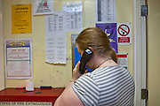 A prisoner making a telephone call how on arrival at HMP Holloway, the main womens prison in London.