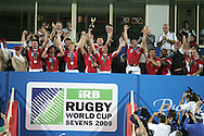 Rugby World cup sevens 2009 in Dubai.  At  the Sevens Stadium, Dubai, pic by Andrew Orchard. Wales v Argentina, RWC Sevens cup final 2009...These pictures are available to purchase here as personal use downloads. Click on image required, add to cart and then at checkout make payment by paypal. Your image purchase will then be prepared ready for you to download. Download image to your computer and get your own print made from the file. Photo (at your expense) may be printed at any good photo lab outlet/supermarket...Or if you prefer, prints may also be purchased..please contact us for pricing if you require an image for editorial purposes