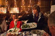 Cohasset, MA 05/11/2013.Holly Hill Farm's Cindy Prentice serves roasted asparagus and turnips during Saturday's dinner..Alex Jones / www.alexjonesphoto.com