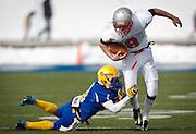 Manti wide running back Zane Stevens (8) drags along San Juan's Bobby Bowring (10) during the Utah High School 2A Football championship game between San Juan and Manti, Saturday, Nov. 10, 2012.