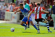 Hartlepool United defender Jake Carroll (3) evades Exeter City midfielder Jake Taylor (25) during the EFL Sky Bet League 2 match between Exeter City and Hartlepool United at St James' Park, Exeter, England on 13 August 2016. Photo by Graham Hunt.