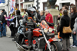 © Licensed to London News Pictures. 18/03/2012.  Royal Wootton Bassett, Wiltshire, UK.  Thousands of motorcyclists ride through Royal Wootton Bassett in a show of respect for UK armed forces. The town was given the title of Royal Wootton Bassett, after the respect shown by the town to the repatriations of dead service personnel brought through the town by hearse from RAF Lyneham.  The repatriations now take place in Oxfordshire and RAF Lyneham is to close...Photo credit : Simon Chapman/LNP