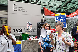 London, UK. 15 July, 2019. Kiri Tunks, Joint President of the NEU trade union addresses catering and cleaning staff belonging to the PCS trade union and outsourced to work at the Department for Business, Energy and Industrial Strategy (BEIS) via contractors ISS World and Aramark on the picket line outside the Government department after walking out on an indefinite strike for the London Living Wage, terms and conditions comparable to the civil servants they work alongside and an end to outsourcing.