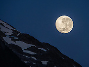 Moonset. Villa Santa Lucia, Palena Province, Chile, Andes mountains, Patagonia, South America. After heavy precipitation leading up to 16 December 2017, a massive landslide and debris flow buried the town, killing at least 15 and cutting road access between Chaitén and Puyuhuapi. In 2020, we found lodging in town to be relocated but operational.
