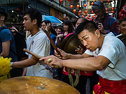 "08 FEBRUARY 2016 - BANGKOK, THAILAND: The drummer for a lion dance troupe performs in Bangkok's Chinatown district during the celebration of the Lunar New Year. Chinese New Year is also called Lunar New Year or Tet (in Vietnamese communities). This year is the ""Year of the Monkey."" Thailand has the largest overseas Chinese population in the world; about 14 percent of Thais are of Chinese ancestry and some Chinese holidays, especially Chinese New Year, are widely celebrated in Thailand.       PHOTO BY JACK KURTZ"