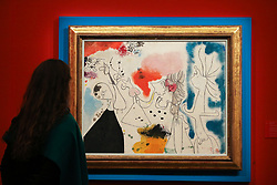 © Licensed to London News Pictures. 29/01/2020. London, UK. A staff member views Joan Miros' painting titled Groupe de personages (est £3m to £5m) at the preview of Sotheby's Impressionist, Modern and Surrealist art sales. The auction will take place at Sotheby's in central London on 4 and 5 February 2020. Photo credit: Dinendra Haria/LNP