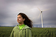 10 year old Isabel enjoys the wind at Portland General Electric's Biglow Wind Farm near the Columbia River in Oregon.