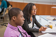Purchase, NY – 31 October 2014. Raymond Uduba from Saunders Trades and Technical High School listening to a discussion. The Business Skills Olympics was founded by the African American Men of Westchester, is sponsored and facilitated by Morgan Stanley, and is open to high school teams in Westchester County.
