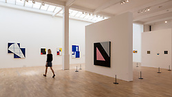 "© Licensed to London News Pictures. 07/06/2016. London, UK.   Works by the American artist Mary Heilmann, are previewed ahead of her first major UK exhibition, ""Looking at Pictures"", at the Whitechapel Gallery.  The exhibition spans the artist's five decade career, from her early geometric paintings made in the 1970s to her recent shaped canvases in day-glo colours.  The show features approximately 45 paintings as well as a selection of ceramics, chairs and works on paper, many of which have never been exhibited.  Photo credit : Stephen Chung/LNP"
