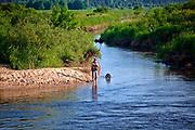 Wędkarz nad rozlewiskami Biebrzy, Polska<br /> Angler at Biebrza floodplains, Poland