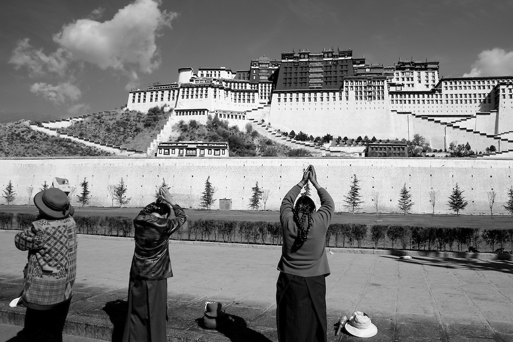The Potala Palace in Lhasa Tibet, former home of the Dalai Lama. People drop and pray when in the presence of this Buddhist spiritual center