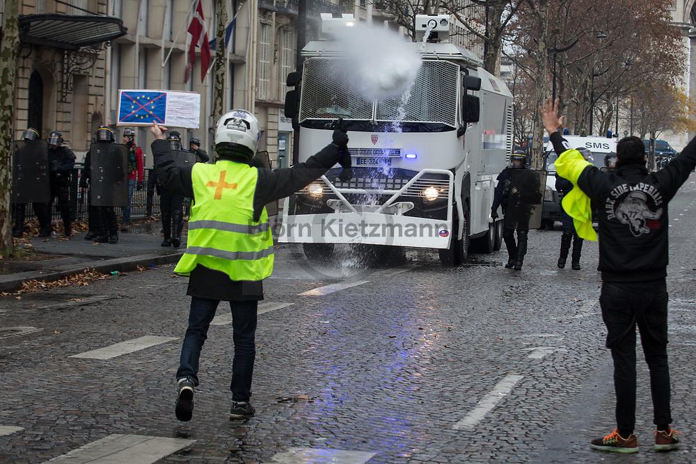 """Paris, France - 08.12.2018<br /> <br /> Clashes in the side streets of the Champs Elysees. Accompanied by heavy riots and more than 1000 arrests, tens of thousands protest on the fourth day of protest of the Yellow Vests (""""Gilet Jaune"""") in Paris.<br /> <br /> Ausschreitungen in den Seitenstraße der Champs Elysees. Begleitet von schweren Ausschreitungen und mehr als 1000 Festnahmen protestieren zehntausende beim vierten Protesttag der Gelben Westen (""""Gilet Jaune"""") in Paris.<br /> <br /> Photo: Bjoern Kietzmann"""