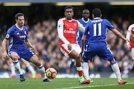 Alex Iwobi of Arsenal (c)  in action. Premier league match, Chelsea v Arsenal at Stamford Bridge in London on Saturday 4th February 2017.<br /> pic by John Patrick Fletcher, Andrew Orchard sports photography.
