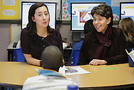 New York State Regents Chancellor Merryl Tisch, right, talks to a student in a third grade inclusion class taught by Anna Agnello, at left,  at Mechanicstown Elementary School during a tour of Middletown schools on Thursday, Jan. 28, 2010.
