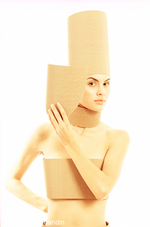 Portrait of woman covered corrugated cardboard looking straight on
