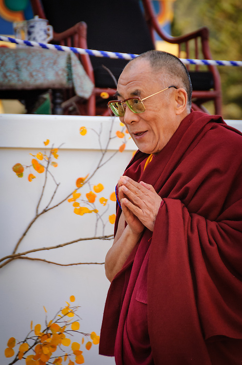 The DALAI LAMA offers thanks as he arrives for the audience blessing at The Great Stupa of Dharmakaya, the largest Buddhist monument in the United States.