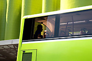 A passenger is silhouetted against the background as he rides on a bus at Novena, Singapore.